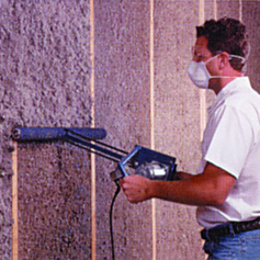 man rolling wall insulation