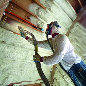 man spraying foam insulation